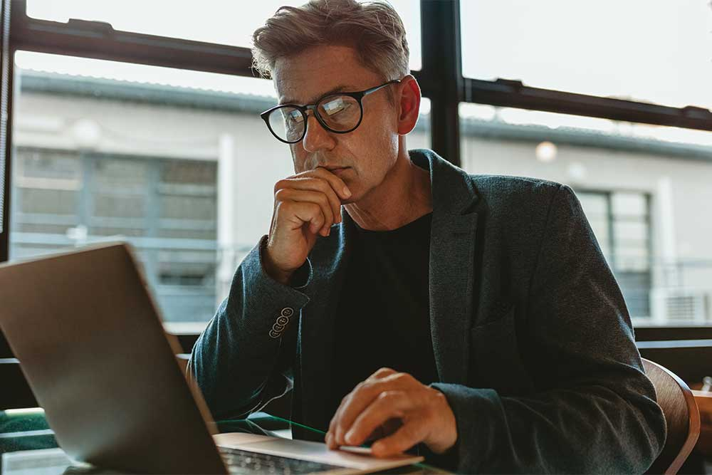 Business professional working on laptop in office