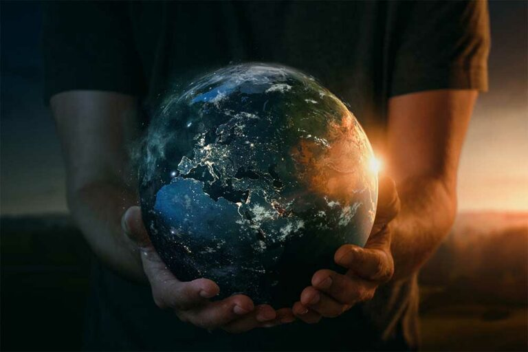 Planet earth in human hands.