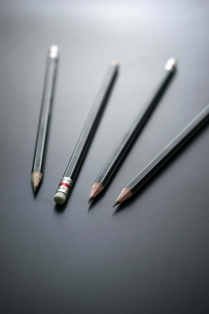 Group of pencils on blackboard focus at pencil eraser